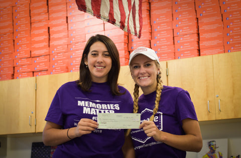 The Walk to End Alzheimer's Purpose Therapy Box Founders Ali Izzo and Holly Masters Holding a donation check
