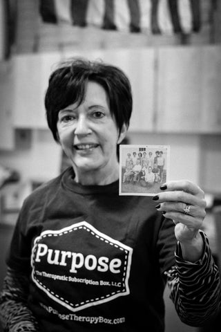 The Walk to End Alzheimer's Purpose Therapy Box- women holding a photo of her grandparents who were affected by Alzheimer's