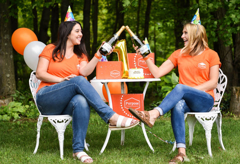 Purpose The Therapeutic Subscription Box 1 Year Celebration Bright Orange Box with Founders Ali Izzo and Holly Masters