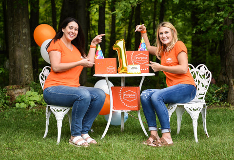 Purpose Therapy Box Founders Ali Izzo (left) and Holly Masters (right) with their bright orange box for grandma