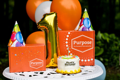 Purpose The Therapeutic Subscription Box 1 Year Celebration Bright Orange Box