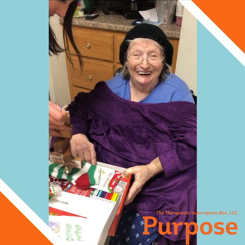 Women holding a Purpose Box and smiling| Sponsor a Senior Program | Purpose The Therapeutic Subscription Box, LLC