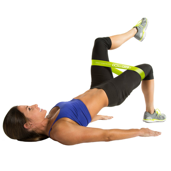 Female wearing  Power Loop  performing glute bridge with leg lift