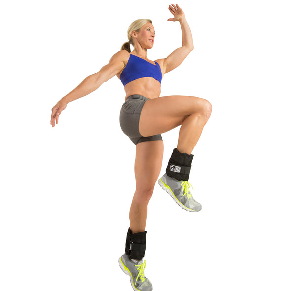 Female performing Standing Knee Raise with Adjustable Ankle Weights