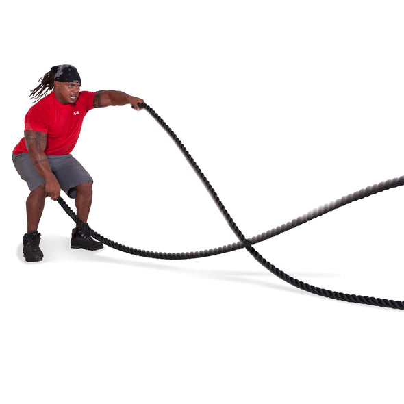 Male performing large alternating waves with Combat Rope