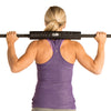 Female utilizing Olympic Barbell Pad