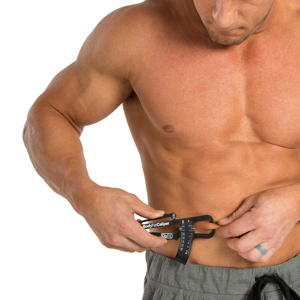 Male utilizing Body Fat Caliper on stomach.