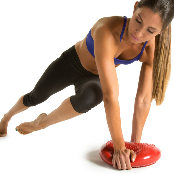 Female performing Knee to Elbow Plank with Core Stability and Balance Disk