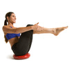 Female performing Boat Pose on Core Stability and Balance Disk