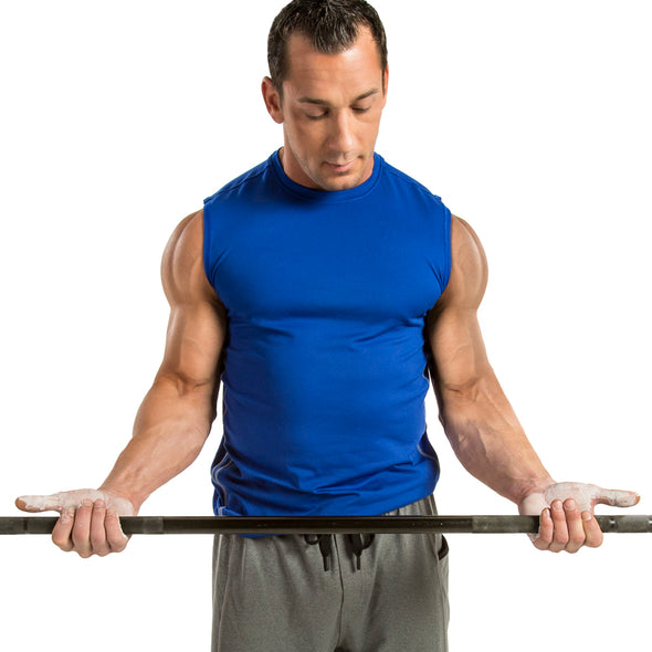 Male holding weight bar with liquid chalk on hands