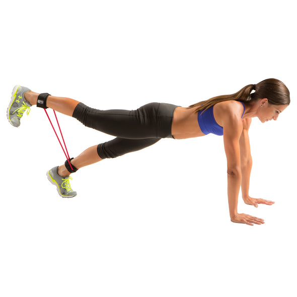 Female using Resist-a-Cuffs while performing plank with single leg raise