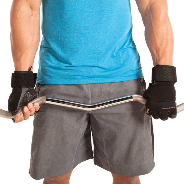 Male wearing Diamond-Tac Wrist Wrap Gloves while holding on to weight bar