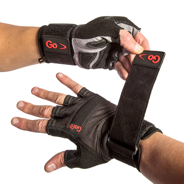 MAle putting on Xtreme Wrist Wrap Gloves with Articulated Grip