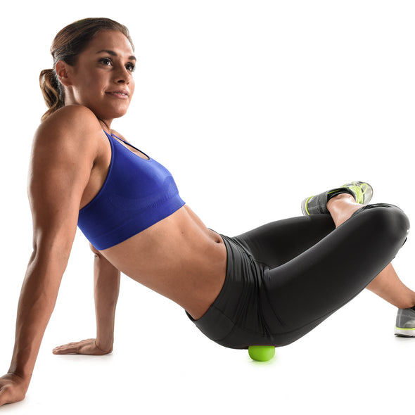 Female rolling glutes with myofascial  release ball