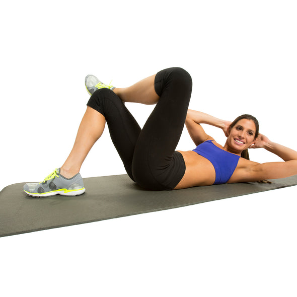 Female performing crunches on Fitness Mat