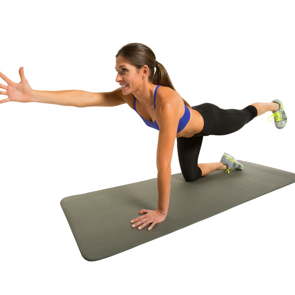 Female performing Bird Dog exercise on Fitness Mat