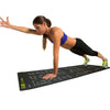 Female performing High Plank w/ Arm Lift on Guide Mat