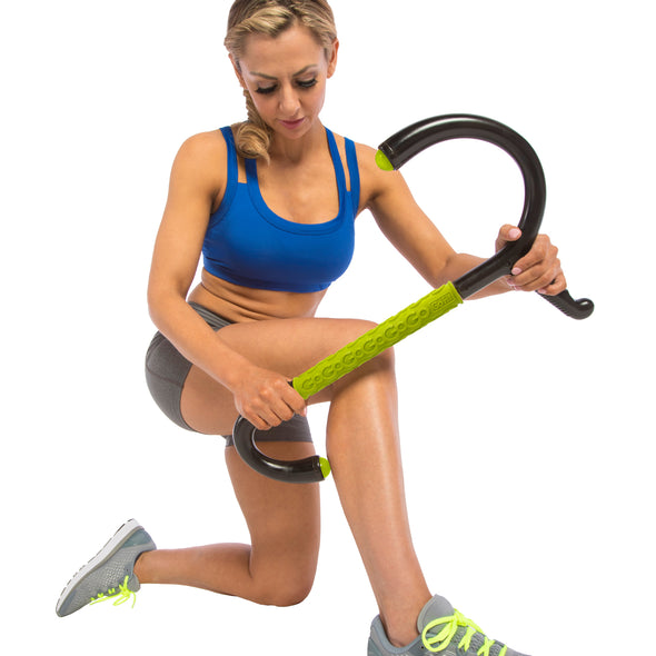 Female rolling upper back with Muscle Hook Multi-Tool