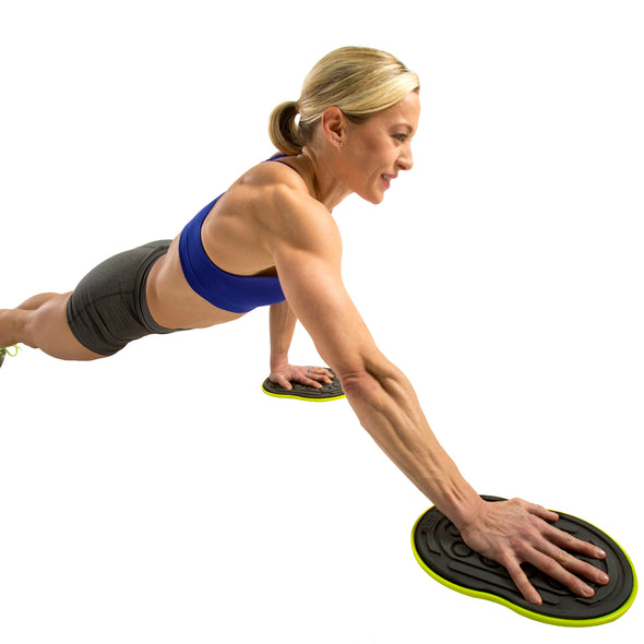 Female performing single hand slide-out in plank position with Go Slides