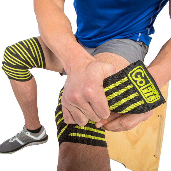 Male putting on Ultra Pro Knee Wraps