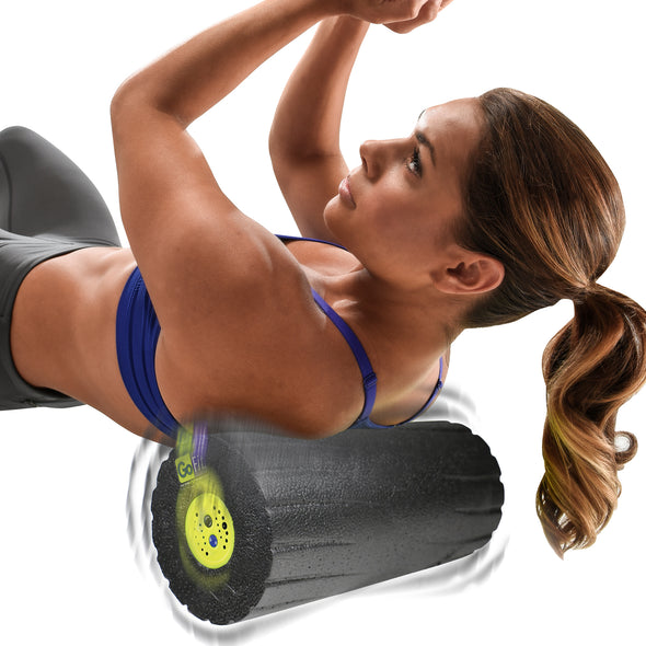 Female rolling upper back w/ Vibrating Massage Roller