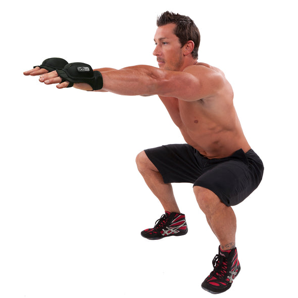 Male squatting w/ Weighted Aerobic Gloves on