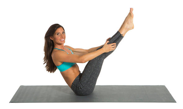 Female using gray Yoga Mat