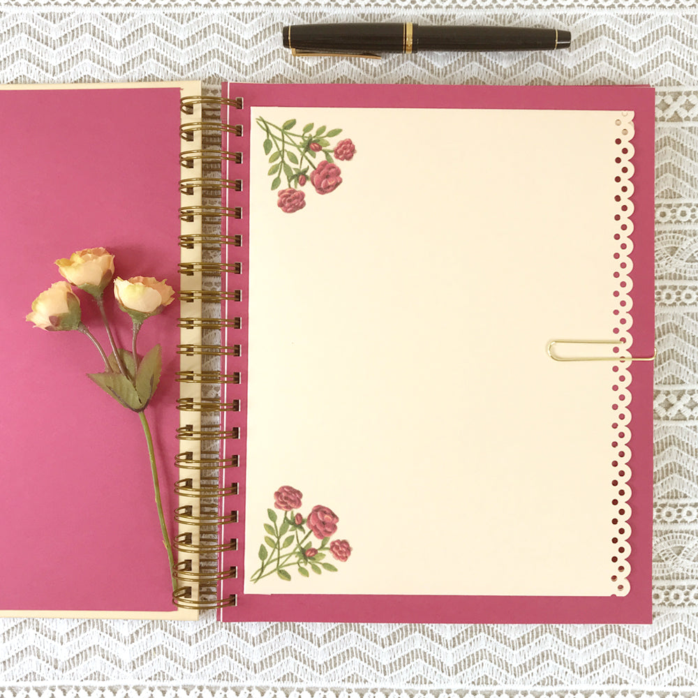 Pocket page of Angel Blessings 8x10 size hardcover journal notebook. Roses embellish the corners of the pocket.