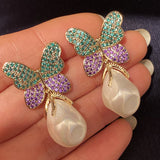 cz butterfly and white irregular pearl drop earring for women wedding