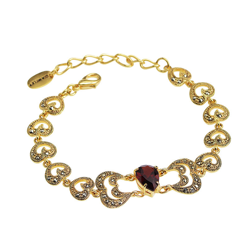 Sparkling Victorian Design 14kt Gold Plated Marcasite Bracelet with Red Crystal Stone.