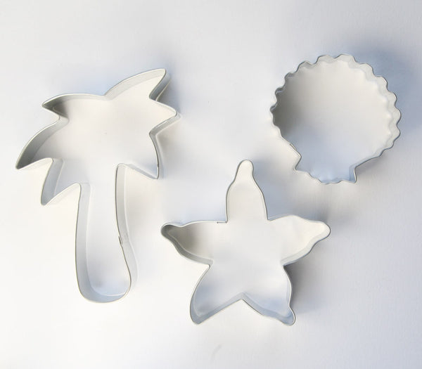 Beach cookie cutter set including a palm tree, starfish and shell