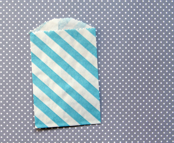 small blue diagonally striped paper bag
