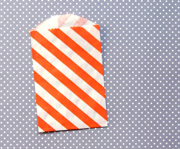 small orange diagonal stripe paper bags