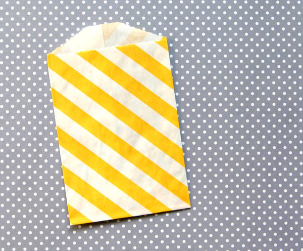small yellow striped paper bags
