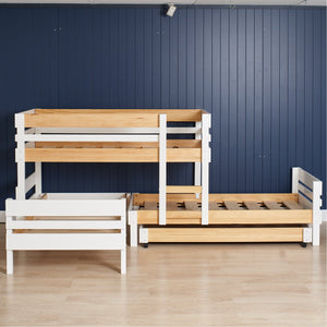 Low height 4 bed bunk. Offest bunk bed plus extra standard bed, with versatile trundle for extra sleeping or storage. Shown in Nordic, white with clear pine.