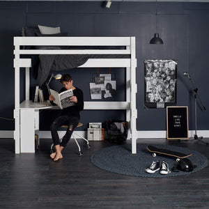 teenage boy at loft bed with study desk
