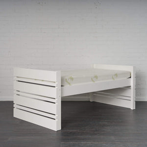 White Captain Bed pictured alone set at higher setting. Angled view to show side and end frame.