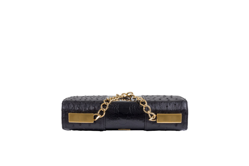 Adele Exclusive Luxury Design Top view Belinda ostrich and ostrich shin top flap clutch bag with top chain handle and 24 carat gold plated decorative hardware . Detachable shoulder strap from chain and leather. Inside back zipper pocket and front inside patch pocket. Suede leather lining and hidden magnetic lock closure.