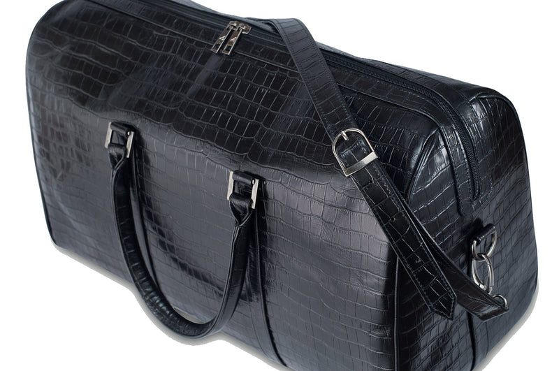 Top side view Chris Embossed Crocodile Leather duffel bag. Double zipper and double carry handle, gun metal hardware. Adjustable detachable shoulder strap. Black suede leather interior, inside zip pocket and two open pockets.