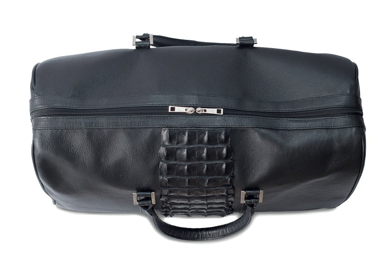 Top view black bovine leather duffel bag crocodile tail insert. Double zipper, double carry handle, nickel hardware. Adjustable detachable shoulder strap. Black cotton twill interior, inside zip pocket, two open pockets.