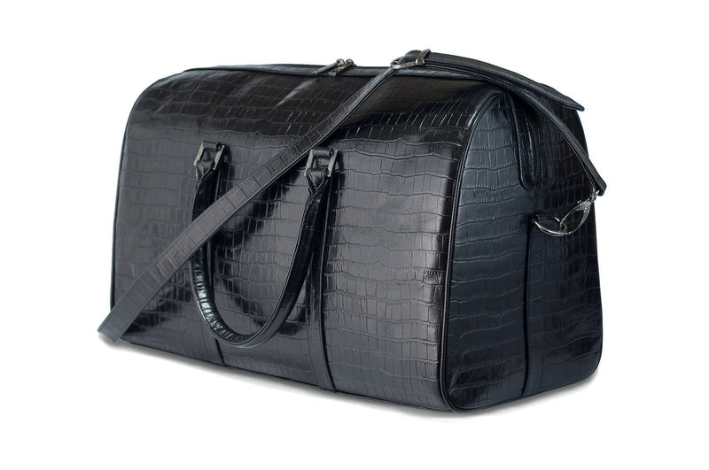 Front side view Chris Embossed Crocodile Leather duffel bag. Double zipper and double carry handle, gun metal hardware. Adjustable detachable shoulder strap. Black suede leather interior, inside zip pocket and two open pockets.