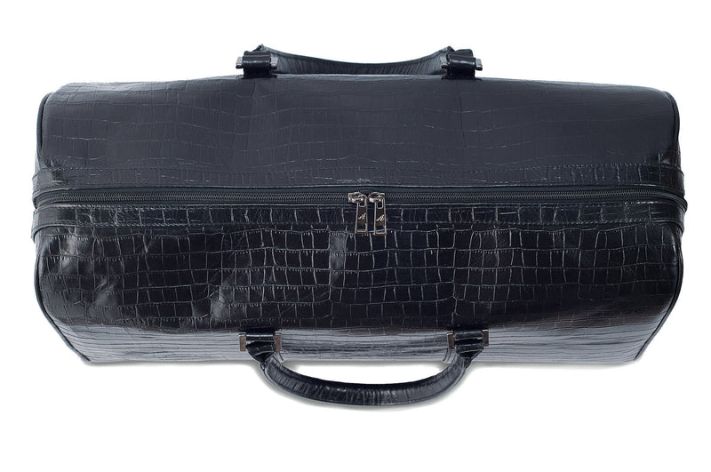 Top view Chris Embossed Crocodile Leather duffel bag. Double zipper and double carry handle, gun metal hardware. Adjustable detachable shoulder strap. Black suede leather interior, inside zip pocket and two open pockets.