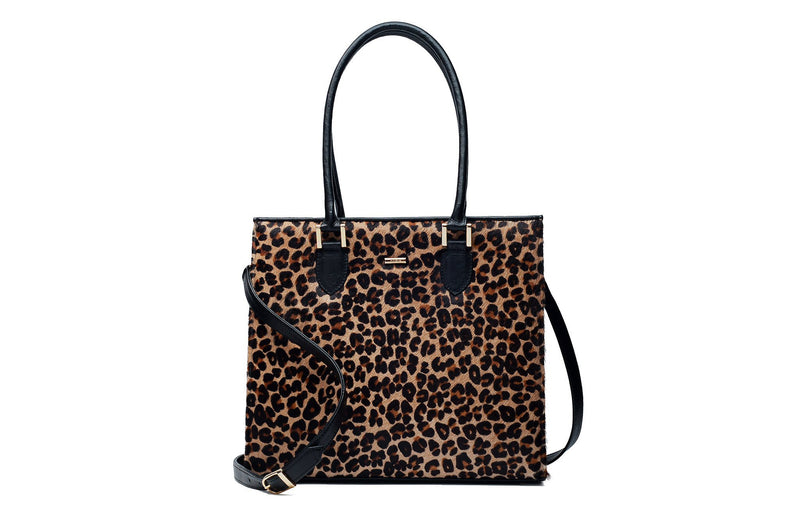 Front view Beverley. Black bovine leather side, back and bottom, with leopard printed hair on hide on the front panel. Contains an inside zipper with a back zip pocket. Bag interior consist of black high quality cotton lining. Top zip closure with gold plated fittings. Comes with a detachable shoulder strap with an adjustable buckle. Bottom panel features bag feet studs.