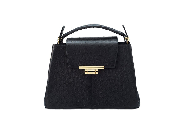 Front view ostrich leather constructed top flap handbag with an Italian lift lock closure. Inside zipper pocket, leather suede interior. Top handle 24 carat gold plated hardware,detachable shoulder strap with adjustable buckle. Bottom feet studs.