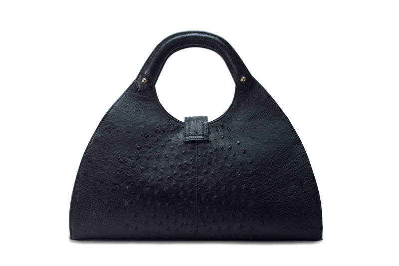 Back view Kimberley black ostrich Leather bag with fold over strap. Hidden magnet with D-ring & tassel decoration for closure. Attached round shaped handles decorated with a studs. Top snap hook closure internal zip pocket with two internal patch pockets. Black high quality suede leather lining, bag feet.