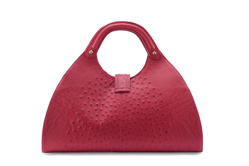Back view Kimberley red ostrich Leather bag with fold over magnetic strap with D-ring & tassel decoration. Attached round shaped handles decorated with a studs.