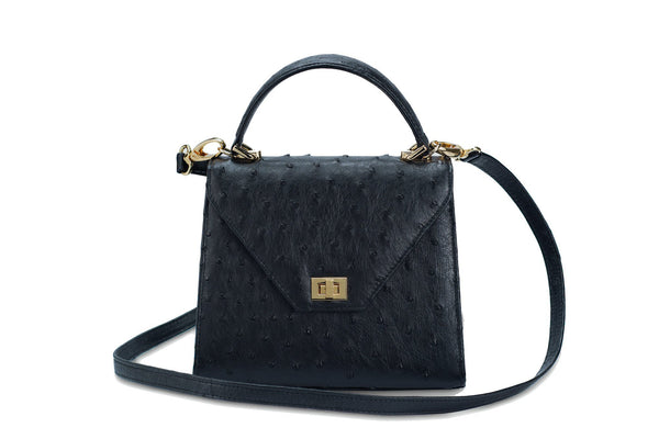 Front view with shoulder strap. Ostrich leather constructed top flap handbag with an Italian turn-lock closure. Inside zipper pocket, leather suede interior. Top handle 24 carat gold plated hardware,detachable shoulder strap with adjustable buckle. Bottom feet studs.