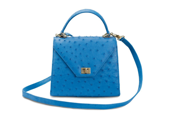 Front view Ostrich leather constructed top flap handbag with an Italian turn-lock closure. Inside zipper pocket, leather suede interior. Top handle 24 carat gold plated hardware,detachable shoulder strap with adjustable buckle. Bottom feet studs.