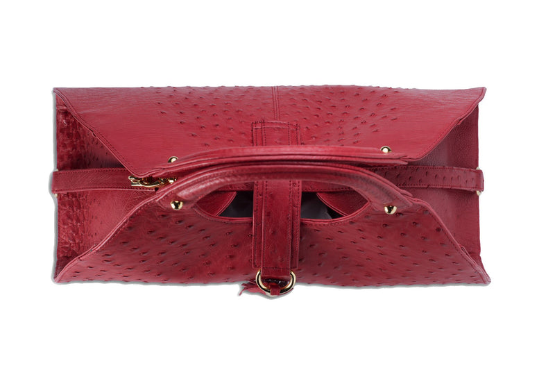 Top view Kimberley red ostrich Leather bag with fold over magnetic strap with D-ring & tassel decoration. Attached round shaped handles decorated with a studs.