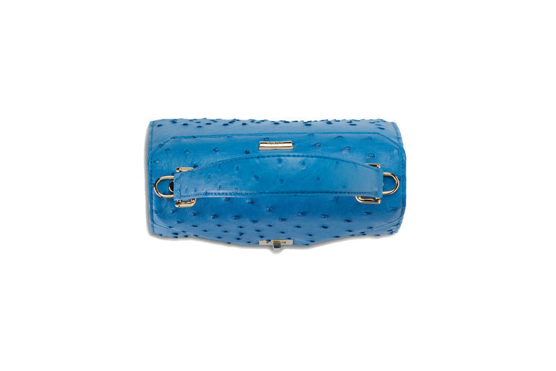 Top view Ostrich leather constructed top flap handbag with an Italian turn-lock closure. Inside zipper pocket, leather suede interior. Top handle 24 carat gold plated hardware,detachable shoulder strap with adjustable buckle. Bottom feet studs.
